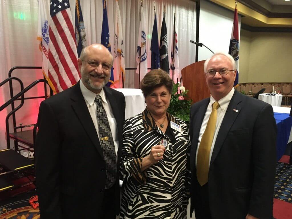Veterans Home Care's Howard and Bonnie Laiderman visit with Lee J. Metcalfe, vice president at Daugherty Business Solutions and retired USN rear admiral.