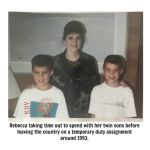 Rebecca taking time out to spend with her twin sons before leaving the country on a temporary duty assignment around 1993.