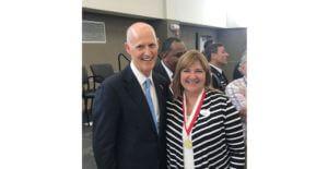 Rebecca with Florida Governor Rick Scott at the Governor's Veterans Service Award ceremony